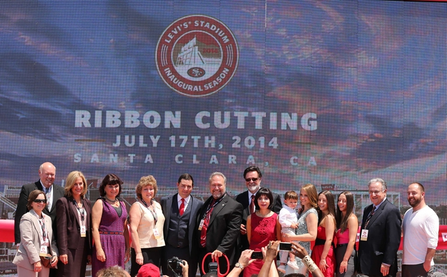Jul 17, 2014; San Francisco, CA, USA; San Francisco 49ere CEO Jed York and Santa Clara mayor Jamie Matthews pose for a photo with family and other dignitaries after the ribbon cutting ceremony at Levi's Stadium. Mandatory Credit: Kelley L Cox-USA TODAY Sports
