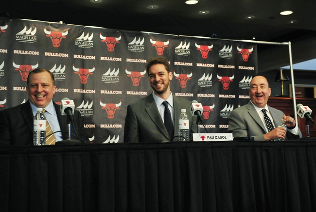 Jul 18, 2014; Chicago, IL, USA; Chicago Bulls head coach Tom Thibodeau (left) and general manager Gar Forman (right) sit with newly signed center Pau Gasol  during a press conference at the United Center. Mandatory Credit: David Banks-USA TODAY Sports