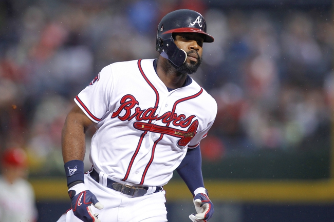 Jul 18, 2014; Atlanta, GA, USA; Atlanta Braves right fielder Jason Heyward (22) rounds third after a home run against the Philadelphia Phillies in the second inning at Turner Field. Mandatory Credit: Brett Davis-USA TODAY Sports