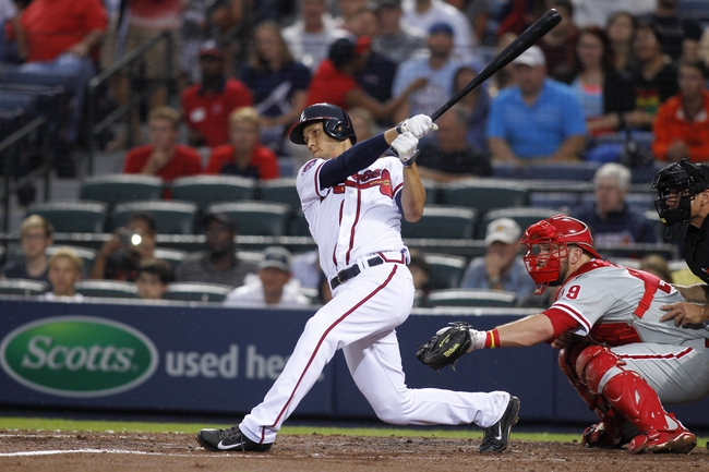 Jul 18, 2014; Atlanta, GA, USA; Atlanta Braves shortstop Andrelton Simmons (19) hits a RBI single against the Philadelphia Phillies in the second inning at Turner Field. Mandatory Credit: Brett Davis-USA TODAY Sports