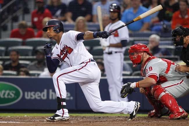 Jul 18, 2014; Atlanta, GA, USA; Atlanta Braves catcher Christian Bethancourt (25) hits a single against the Philadelphia Phillies in the second inning at Turner Field. Mandatory Credit: Brett Davis-USA TODAY Sports