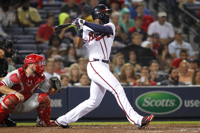 Jul 18, 2014; Atlanta, GA, USA; Atlanta Braves right fielder Jason Heyward (22) hits a RBI single against the Philadelphia Phillies in the fifth inning at Turner Field. Mandatory Credit: Brett Davis-USA TODAY Sports