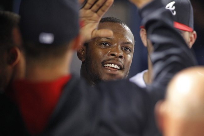 Jul 18, 2014; Atlanta, GA, USA; Atlanta Braves left fielder Justin Upton (8) celebrates with teammates after scoring a run against the Philadelphia Phillies in the fifth inning at Turner Field. Mandatory Credit: Brett Davis-USA TODAY Sports