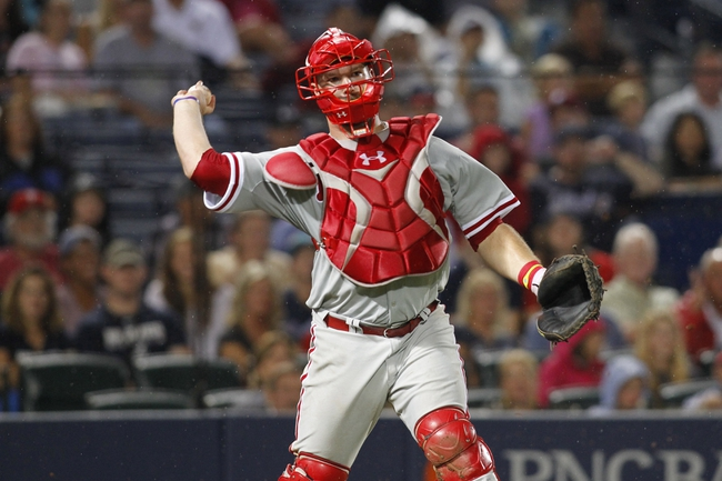 Jul 18, 2014; Atlanta, GA, USA; Philadelphia Phillies catcher Cameron Rupp (29) throws a runner out at first against the Atlanta Braves in the fifth inning at Turner Field. Mandatory Credit: Brett Davis-USA TODAY Sports