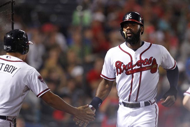 Jul 18, 2014; Atlanta, GA, USA; Atlanta Braves right fielder Jason Heyward (22) celebrates after scoring a run against the Philadelphia Phillies in the fifth inning at Turner Field. Mandatory Credit: Brett Davis-USA TODAY Sports