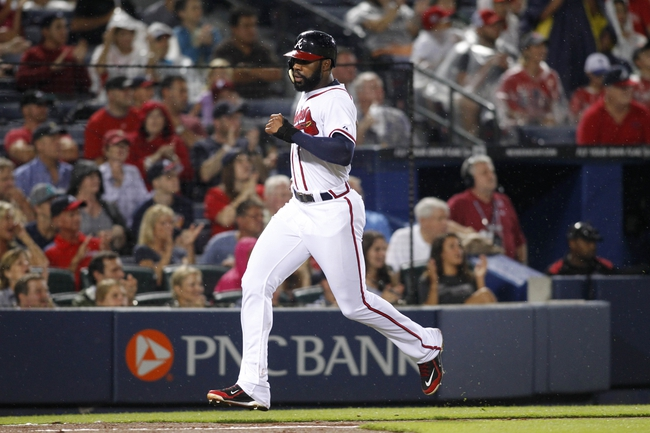 Jul 18, 2014; Atlanta, GA, USA; Atlanta Braves right fielder Jason Heyward (22) scores a run against the Philadelphia Phillies in the fifth inning at Turner Field. Mandatory Credit: Brett Davis-USA TODAY Sports