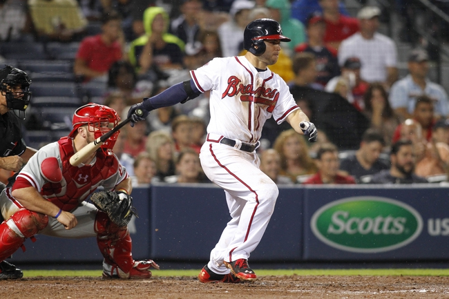 Jul 18, 2014; Atlanta, GA, USA; Atlanta Braves second baseman Tommy La Stella (7) hits a RBI single against the Philadelphia Phillies in the fifth inning at Turner Field. Mandatory Credit: Brett Davis-USA TODAY Sports