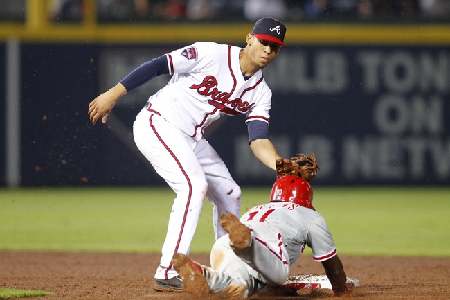 Jul 18, 2014; Atlanta, GA, USA; Atlanta Braves shortstop Andrelton Simmons (19) tags out Philadelphia Phillies shortstop Jimmy Rollins (11) in the eighth inning at Turner Field. Mandatory Credit: Brett Davis-USA TODAY Sports