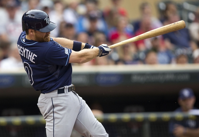 Jul 19, 2014; Minneapolis, MN, USA; Tampa Bay Rays second baseman Logan Forsythe (10) hits a single in the second inning against the Minnesota Twins at Target Field. Mandatory Credit: Jesse Johnson-USA TODAY Sports