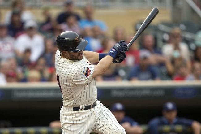 Jul 19, 2014; Minneapolis, MN, USA; Minnesota Twins third baseman Trevor Plouffe (24) hits a double in the first inning against the Tampa Bay Rays at Target Field. Mandatory Credit: Jesse Johnson-USA TODAY Sports