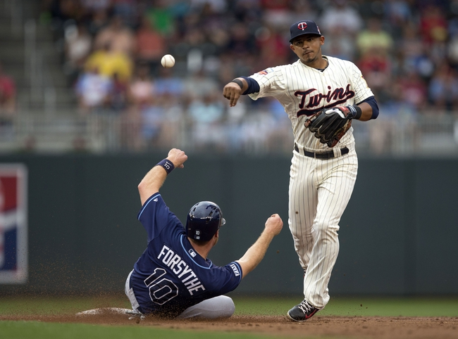 Jul 19, 2014; Minneapolis, MN, USA; Minnesota Twins shortstop Eduardo Escobar (5) forces out Tampa Bay Rays second baseman Logan Forsythe (10) at second base and throws the ball to first base for a double play in the second inning at Target Field. Mandatory Credit: Jesse Johnson-USA TODAY Sports