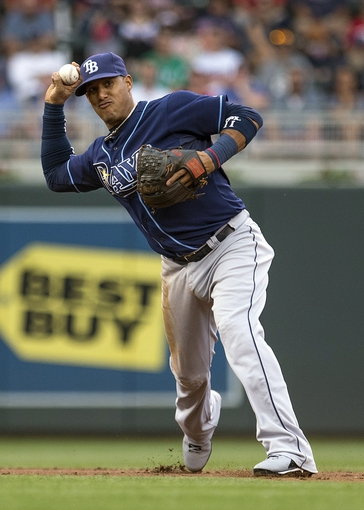 Jul 19, 2014; Minneapolis, MN, USA; Tampa Bay Rays shortstop Yunel Escobar (11) throws the ball to first base for an out in the first inning against the Minnesota Twins at Target Field. Mandatory Credit: Jesse Johnson-USA TODAY Sports