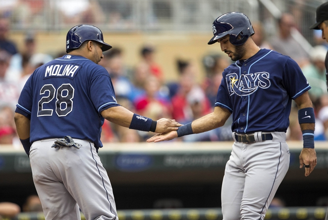 Jul 19, 2014; Minneapolis, MN, USA; Tampa Bay Rays designated hitter Sean Rodriguez (1) celebrates with catcher Jose Molina (28) after hitting a home run in the second inning against the Minnesota Twins at Target Field. Mandatory Credit: Jesse Johnson-USA TODAY Sports