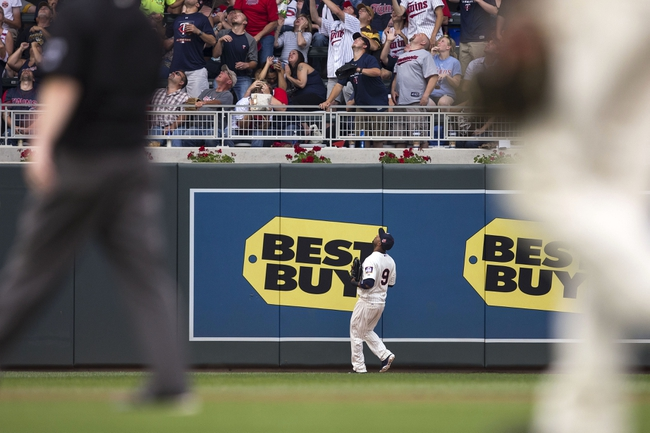 Jul 19, 2014; Minneapolis, MN, USA; Minnesota Twins left fielder Eduardo Nunez (9) watches a home run leave the park by Tampa Bay Rays designated hitter Sean Rodriguez (not pictured) in the second inning at Target Field. Mandatory Credit: Jesse Johnson-USA TODAY Sports