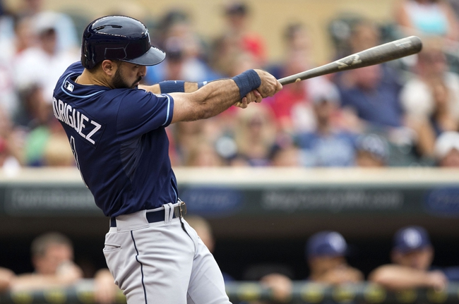 Jul 19, 2014; Minneapolis, MN, USA; Tampa Bay Rays designated hitter Sean Rodriguez (1) hits a two run home run in the second inning against the Minnesota Twins at Target Field. Mandatory Credit: Jesse Johnson-USA TODAY Sports