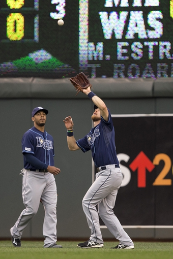 Jul 19, 2014; Minneapolis, MN, USA; Tampa Bay Rays right fielder Ben Zobrist (18) catches a fly ball in the second inning against the Minnesota Twins at Target Field. Mandatory Credit: Jesse Johnson-USA TODAY Sports