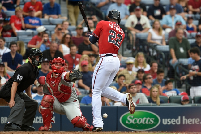 Jul 19, 2014; Atlanta, GA, USA; Atlanta Braves right fielder Jason Heyward (22) is hit by a pitch in front of Philadelphia Phillies catcher Cameron Rupp (29) during the second inning at Turner Field. Mandatory Credit: Dale Zanine-USA TODAY Sports