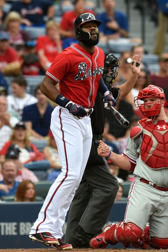 Jul 19, 2014; Atlanta, GA, USA; Atlanta Braves right fielder Jason Heyward (22) reacts after being hit by a pitch in front of Philadelphia Phillies catcher Cameron Rupp (29) during the second inning at Turner Field. Mandatory Credit: Dale Zanine-USA TODAY Sports