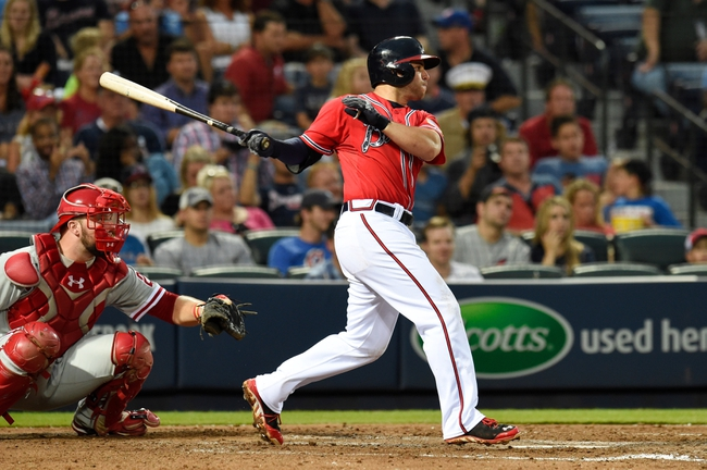 Jul 19, 2014; Atlanta, GA, USA; Atlanta Braves second baseman Tommy La Stella (7) doubles for the Braves' first hit against Philadelphia Phillies starting pitcher Cole Hamels (35) (not shown) during the fifth inning at Turner Field. Mandatory Credit: Dale Zanine-USA TODAY Sports