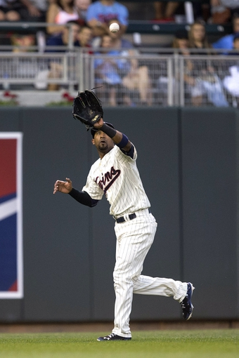 Jul 19, 2014; Minneapolis, MN, USA; Minnesota Twins left fielder Eduardo Nunez (9) catches a fly ball in the seventh inning against the Tampa Bay Rays at Target Field. Mandatory Credit: Jesse Johnson-USA TODAY Sports
