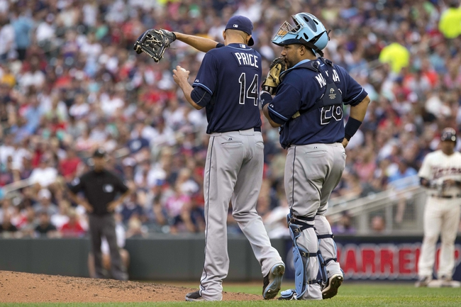 Jul 19, 2014; Minneapolis, MN, USA; Tampa Bay Rays catcher Jose Molina (28) talks to starting pitcher David Price (14) after giving up back to back singles in the fifth inning against the Minnesota Twins at Target Field. Mandatory Credit: Jesse Johnson-USA TODAY Sports