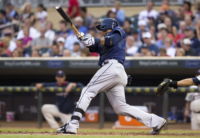 Jul 19, 2014; Minneapolis, MN, USA; Tampa Bay Rays shortstop Yunel Escobar (11) hits a single in the seventh inning against the Minnesota Twins at Target Field. Mandatory Credit: Jesse Johnson-USA TODAY Sports