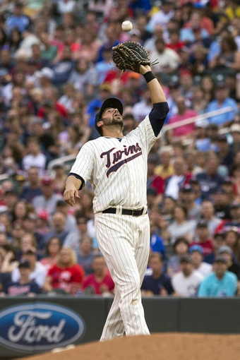 Jul 19, 2014; Minneapolis, MN, USA; Minnesota Twins first baseman Chris Colabello (20) catches a fly ball in the sixth inning against the Tampa Bay Rays at Target Field. Mandatory Credit: Jesse Johnson-USA TODAY Sports