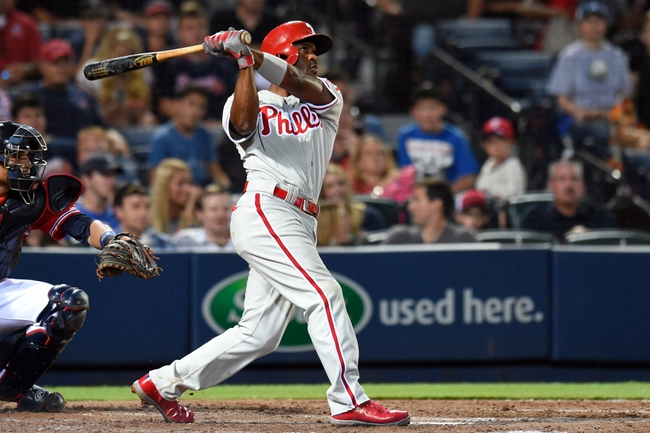 Jul 19, 2014; Atlanta, GA, USA; Philadelphia Phillies shortstop Jimmy Rollins (11) hits a two run home run against the Atlanta Braves during the seventh inning at Turner Field. Mandatory Credit: Dale Zanine-USA TODAY Sports