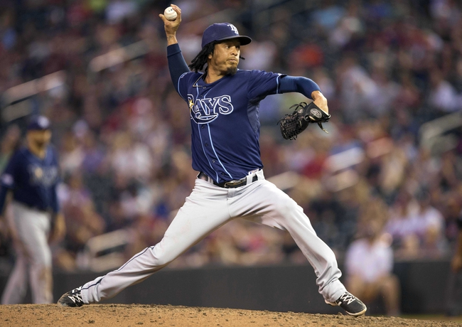 Jul 19, 2014; Minneapolis, MN, USA; Tampa Bay Rays relief pitcher Juan Carlos Oviedo (46) delivers a pitch in the ninth inning against the Minnesota Twins at Target Field. The Rays won 5-1. Mandatory Credit: Jesse Johnson-USA TODAY Sports