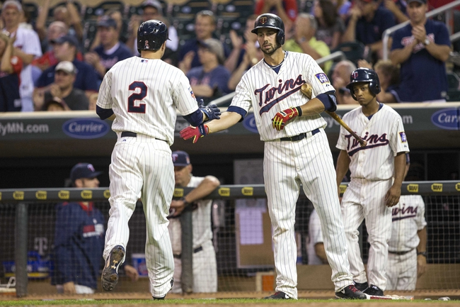 Jul 19, 2014; Minneapolis, MN, USA; Minnesota Twins second baseman Brian Dozier (2) celebrates with first baseman Chris Colabello (20) after scoring a run in the ninth inning against the Tampa Bay Rays at Target Field. The Rays won 5-1. Mandatory Credit: Jesse Johnson-USA TODAY Sports