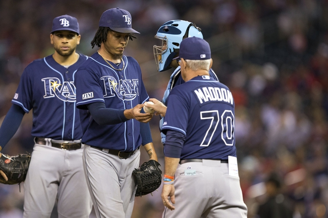 Jul 19, 2014; Minneapolis, MN, USA; Tampa Bay Rays manager Joe Maddon (70) pulls relief pitcher Juan Carlos Oviedo (46) from the game in the ninth inning against the Minnesota Twins at Target Field. The Rays won 5-1. Mandatory Credit: Jesse Johnson-USA TODAY Sports