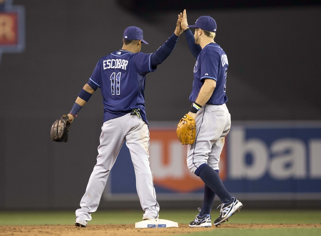 Jul 19, 2014; Minneapolis, MN, USA; Tampa Bay Rays shortstop Yunel Escobar (11) celebrates with third baseman Evan Longoria (3) after beating the Minnesota Twins at Target Field. The Rays won 5-1. Mandatory Credit: Jesse Johnson-USA TODAY Sports