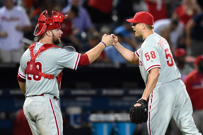 Jul 19, 2014; Atlanta, GA, USA; Philadelphia Phillies relief pitcher Jonathan Papelbon (58) and catcher Cameron Rupp (29) react after defeating the Atlanta Braves at Turner Field. The Phillies defeated the Braves 2-1. Mandatory Credit: Dale Zanine-USA TODAY Sports