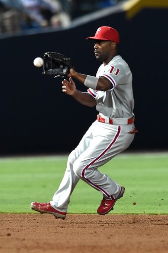 Jul 19, 2014; Atlanta, GA, USA; Philadelphia Phillies shortstop Jimmy Rollins (11) fields a ground ball for an out against the Atlanta Braves during the ninth inning at Turner Field. The Phillies defeated the Braves 2-1. Mandatory Credit: Dale Zanine-USA TODAY Sports
