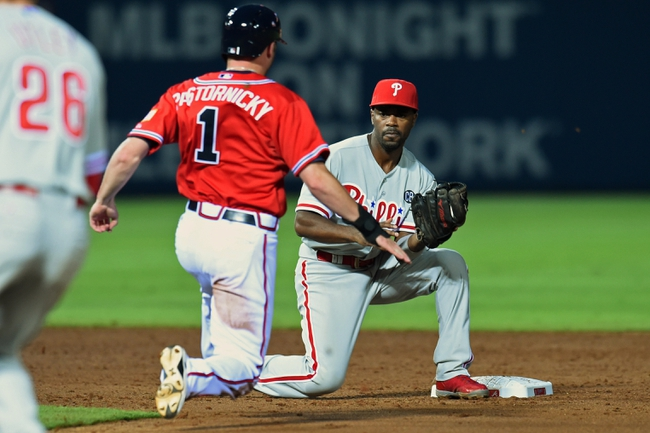Jul 19, 2014; Atlanta, GA, USA; Philadelphia Phillies shortstop Jimmy Rollins (11) prepares to tag out Atlanta Braves pinch hitter Tyler Pastornicky (1) who was caught stealing during the sixth inning at Turner Field. The Phillies defeated the Braves 2-1. Mandatory Credit: Dale Zanine-USA TODAY Sports