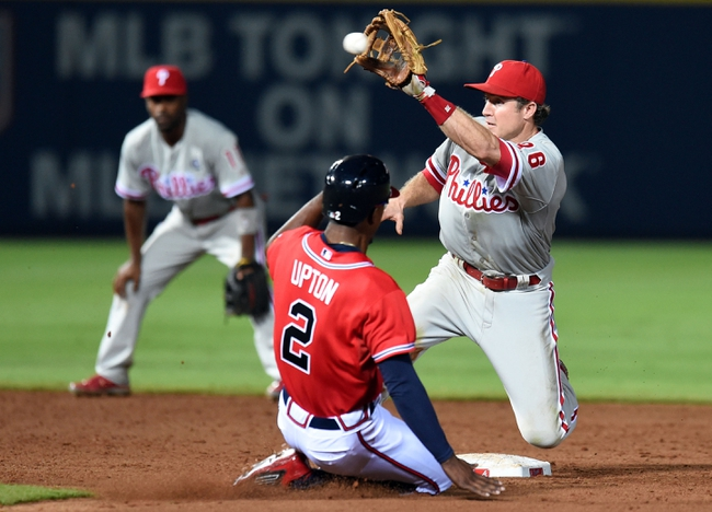 Jul 19, 2014; Atlanta, GA, USA; Philadelphia Phillies second baseman Chase Utley (26) takes a throw before tagging out Atlanta Braves center fielder B.J. Upton (2) as he attempts to steal second base during the eighth inning at Turner Field. The Phillies defeated the Braves 2-1. Mandatory Credit: Dale Zanine-USA TODAY Sports