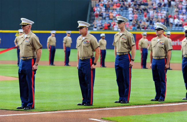 Jul 19, 2014; Atlanta, GA, USA; USA Marines shown on the field while being honored prior to the game between the Atlanta Braves and the Philadelphia Phillies at Turner Field. The Phillies defeated the Braves 2-1. Mandatory Credit: Dale Zanine-USA TODAY Sports
