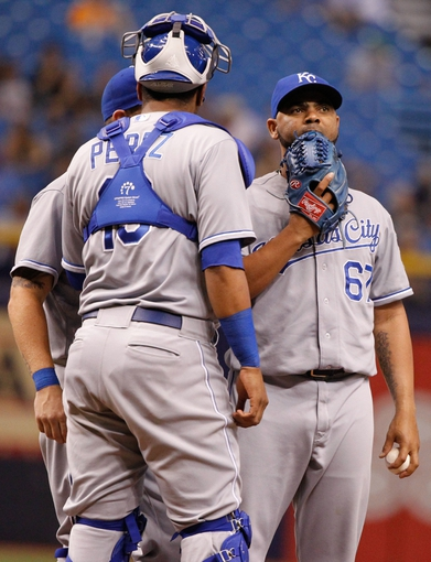 Jul 8, 2014; St. Petersburg, FL, USA; Kansas City Royals relief pitcher Francisley Bueno (67) reacts on the mound with catcher Salvador Perez (13) against the Tampa Bay Rays at Tropicana Field. Tampa Bay Rays defeated the Kansas City Royals 4-3. Mandatory Credit: Kim Klement-USA TODAY Sports