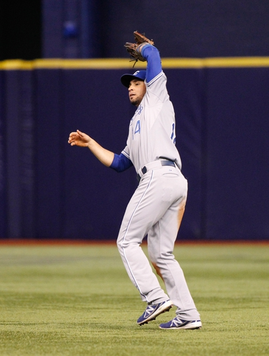 Jul 8, 2014; St. Petersburg, FL, USA; Kansas City Royals second baseman Omar Infante (14) catches a fly ball against the Tampa Bay Rays at Tropicana Field. Mandatory Credit: Kim Klement-USA TODAY Sports