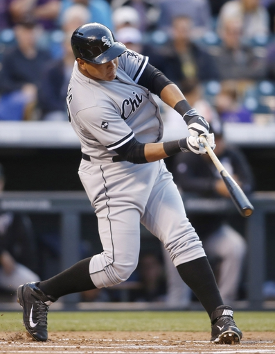Apr 8, 2014; Denver, CO, USA; Chicago White Sox right fielder Avisail Garcia (26) hits a home run during the second inning against the Colorado Rockies at Coors Field. Mandatory Credit: Chris Humphreys-USA TODAY Sports
