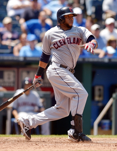 Jun 11, 2014; Kansas City, MO, USA; Cleveland Indians third baseman Carlos Santana (41) connects for a one run single in the sixth inning against the Kansas City Royals at Kauffman Stadium. The Royals won 4-1. Mandatory Credit: Denny Medley-USA TODAY Sports
