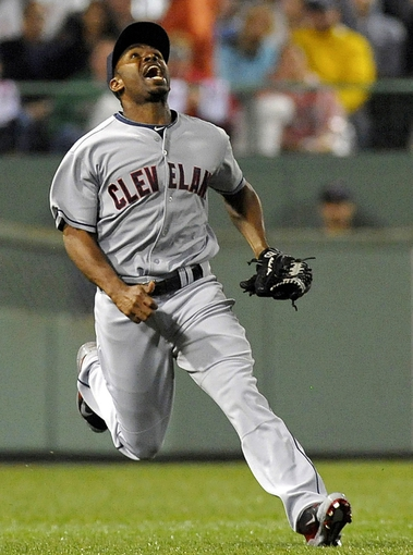 Jun 13, 2014; Boston, MA, USA; Cleveland Indians center fielder Michael Bourn (24) calls for a fly ball during the sixth inning against the Boston Red Sox at Fenway Park. Mandatory Credit: Bob DeChiara-USA TODAY Sports