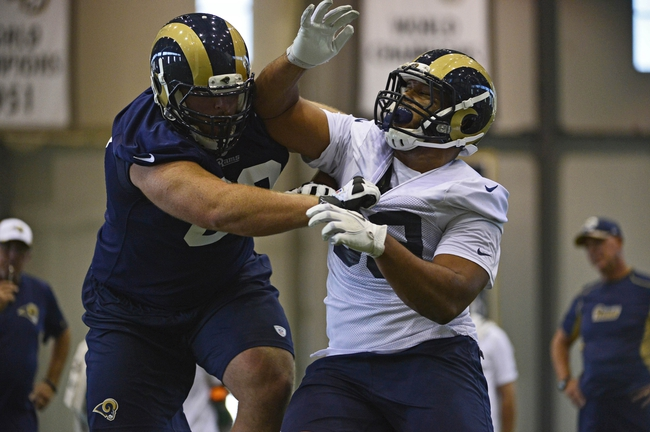 Jul 22, 2014; St. Louis, MO, USA; St. Louis Rams defensive tackle Aaron Donald (99) runs through drills at Rams Park. Mandatory Credit: Jeff Curry-USA TODAY Sports