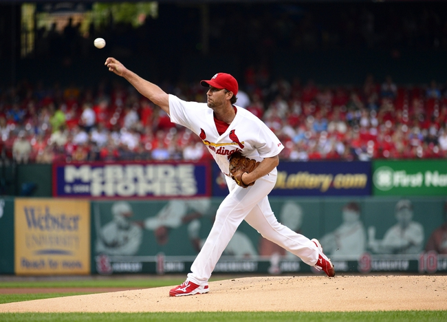 Jul 22, 2014; St. Louis, MO, USA; St. Louis Cardinals starting pitcher Adam Wainwright (50) throws to a Tampa Bay Rays batter during the first inning at Busch Stadium. Mandatory Credit: Jeff Curry-USA TODAY Sports