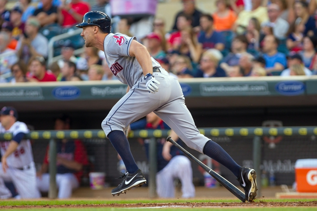 Jul 22, 2014; Minneapolis, MN, USA; Cleveland Indians right fielder David Murphy (7) hits an RBI single in the second inning against the Minnesota Twins at Target Field. Mandatory Credit: Brad Rempel-USA TODAY Sports