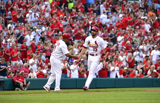 Jul 22, 2014; St. Louis, MO, USA; St. Louis Cardinals third baseman Matt Carpenter (13) is congratulated by third base coach Jose Oquendo (11) after hitting a solo home run off of Tampa Bay Rays starting pitcher Jake Odorizzi (not pictured) during the first inning at Busch Stadium. Mandatory Credit: Jeff Curry-USA TODAY Sports