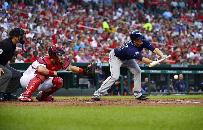 Jul 22, 2014; St. Louis, MO, USA; Tampa Bay Rays starting pitcher Jake Odorizzi (23) lays down a one run sacrifice bunt off of St. Louis Cardinals starting pitcher Adam Wainwright (not pictured) during the second inning at Busch Stadium. Mandatory Credit: Jeff Curry-USA TODAY Sports