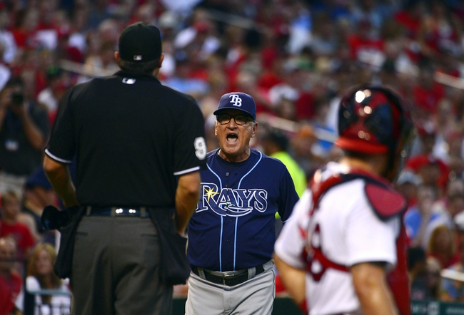 Jul 22, 2014; St. Louis, MO, USA; Tampa Bay Rays manager Joe Maddon (70) is ejected from the game by umpire Mark Ripperger (90) during the third inning against the St. Louis Cardinals at Busch Stadium. Mandatory Credit: Jeff Curry-USA TODAY Sports