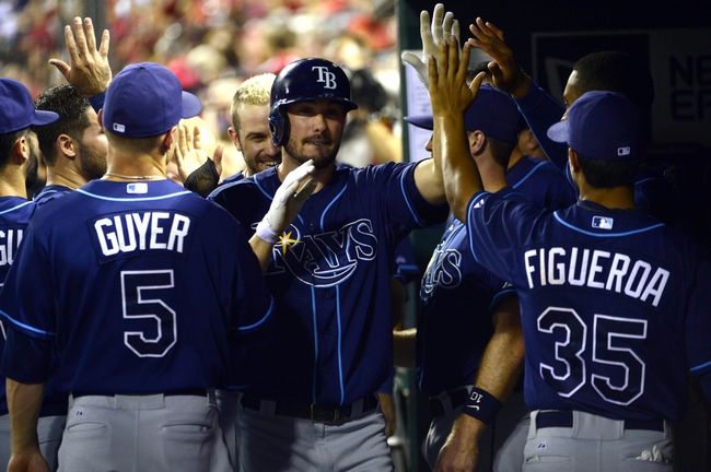 Jul 22, 2014; St. Louis, MO, USA; Tampa Bay Rays left fielder Matt Joyce (20) is congratulated by teammates after driving in a run and scoring during the fifth inning against the St. Louis Cardinals at Busch Stadium. Mandatory Credit: Jeff Curry-USA TODAY Sports