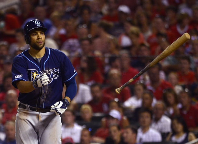 Jul 22, 2014; St. Louis, MO, USA; Tampa Bay Rays first baseman James Loney (21) tosses his bat after walking with the bases loaded during the fifth inning against the St. Louis Cardinals at Busch Stadium. Mandatory Credit: Jeff Curry-USA TODAY Sports
